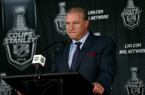 Habs coach Michel Therrien behind podium