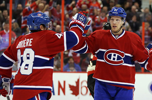 Habs Lars Eller high five with Daniel Brière